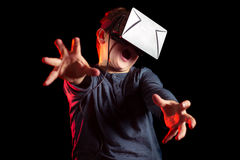 Boy experiencing virtual reality. On the black background Stock Photo