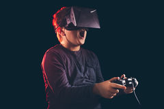 Boy experiencing virtual reality. Child experiencing virtual reality on the black Royalty Free Stock Photos