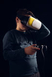 Boy experiencing virtual reality. Child experiencing virtual reality on the black Royalty Free Stock Image