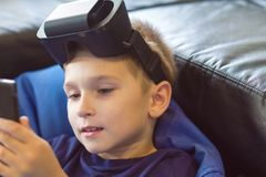 Boy experiencing virtual reality Stock Photo