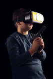 Boy experiencing virtual reality. NChild experiencing virtual reality on the black Royalty Free Stock Image