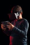 Boy experiencing virtual reality. NChild experiencing virtual reality on the black Royalty Free Stock Photos