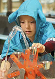 A Boy Experiments with Water at the Discovery Children`s Museum, Royalty Free Stock Photo