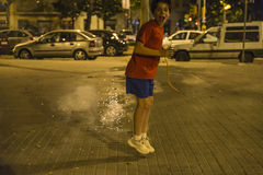 Boy exploding firecrackers, Barcelona Stock Photo