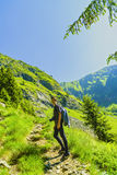 Boy explores nature on the mountain Royalty Free Stock Images