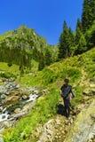 Boy explores nature on the mountain Stock Photos