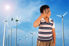 Boy exploring nature with magnifying glass Stock Image