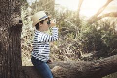 Boy scout. Boy exploring the outdoors with binoculars Stock Photo