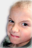Boy Expressions 8. Boy with devilish expression Royalty Free Stock Photography