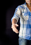 Boy extending hand shake indian Stock Image