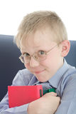 Boy in eyeglasses embrace three interesting books Stock Photo