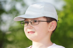 Boy in eyeglasses looking sideways Royalty Free Stock Photo
