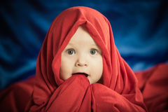 Boy in fabric Royalty Free Stock Images
