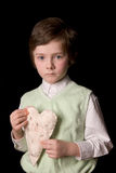Boy with fabric heart Royalty Free Stock Images