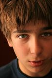 Boy face close up. Teenager looking into the camera and talking royalty free stock photos