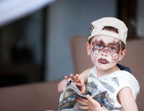 Boy with face painted Royalty Free Stock Image