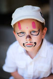 Boy with face painted Stock Photo