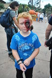Boy with face painted Stock Images