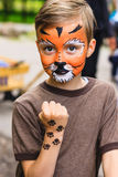 Boy with face painting tiger Stock Photo