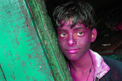 A BOY FACE SMEARED WITH COLOUR Stock Image