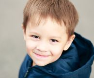 Boy face smiling. Little 4 years old boy face smiling outdoor Stock Photo