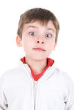 Boy faces. Young boy making faces isolated in white royalty free stock photos