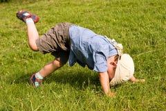 Boy fall down in park. Running boy fall down in park Stock Photos
