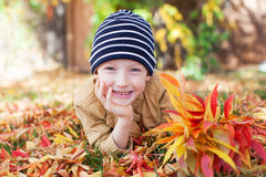 Boy at fall time Stock Photos