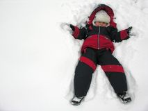 Boy fall to snowbank Stock Photos