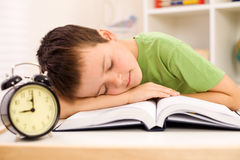 Boy fallen asleep on his book while studying Royalty Free Stock Images