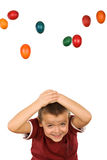 Boy with falling easter eggs Royalty Free Stock Photos