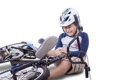 Boy falling from his bike Royalty Free Stock Image
