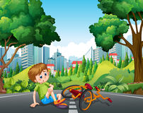 Boy falling off the bike on the street Stock Photography