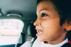 Boy falling tooth. Boy showing falling tooth in car Stock Photo
