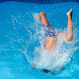 Boy Falling Into Water Royalty Free Stock Photos