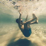 Boy falling in water Royalty Free Stock Photography