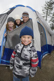 Boy And Family Enjoying Camping Stock Photos