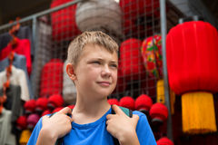 Boy on the famous Panjiayuan Antique Market in Beijing Royalty Free Stock Image