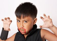 Boy with fangs Royalty Free Stock Photos