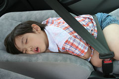 Boy fasten seat belt sleeping Royalty Free Stock Photos