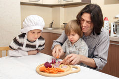 A boy with father cut onion Stock Photo