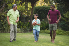 Boy with father and grandfather at park royalty free stock image