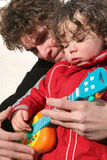 Boy and father with guitar Stock Images