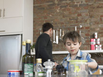 Boy And Father In Kitchen Royalty Free Stock Photos