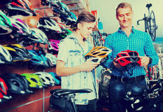 Boy with father looking for helmet Royalty Free Stock Image