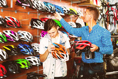 Boy with father looking for helmet Royalty Free Stock Photos