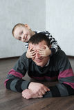 Boy father lying on the floor at home Royalty Free Stock Photos