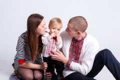 Boy with father and mother on white. Background Royalty Free Stock Image