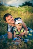 Boy and father on picnic Royalty Free Stock Photo