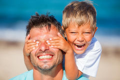Boy with father playing at the beach Royalty Free Stock Photo